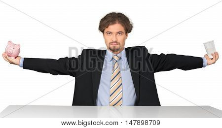 Portrait of a Businessman with Arms Open Holding a Paper Coffee Cup and a Piggy Bank