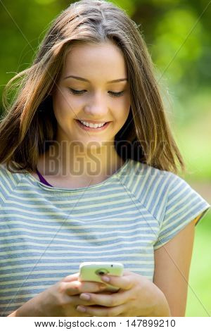 Portrait of a Young Woman Using Smartphone