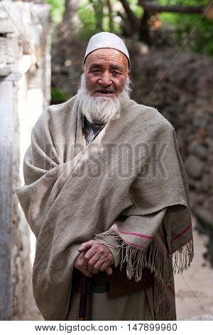 TURTUK, INDIA - JUNE 13: An unidentified Balti man poses for a photo on June 13, 2012 in Turtuk Village, Ladakh, India