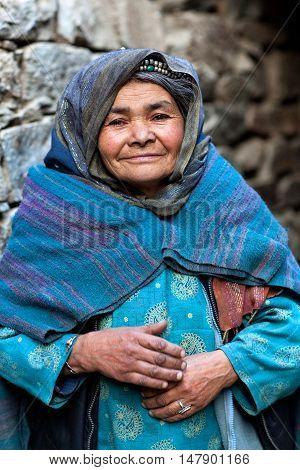 TURTUK, INDIA - JUNE 13: An unidentified Balti woman poses for a photo during Turtuk festival on June 13, 2012 in Turtuk Village, Ladakh, India