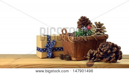 Pine cones and seeds in a wooden basket old and christmas gift for loved ones. / Celebration of Christmas in the cold taiga. / Natural decoration for home comfort and holiday atmosphere. \ Isolation on a white background without shadows /.