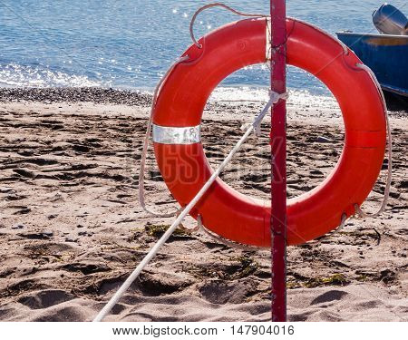Red lifebelt on the beach. Ionian Sea Calabria. Italy