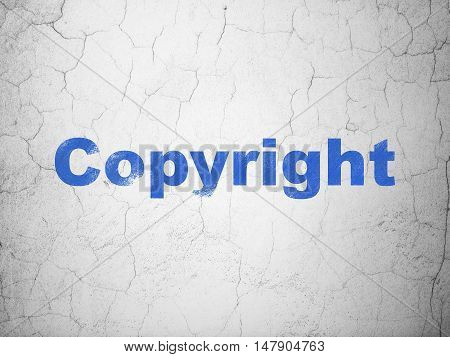 Law concept: Blue Copyright on textured concrete wall background