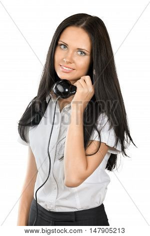 Beautiful young brunette businesswoman on old fashioned phone