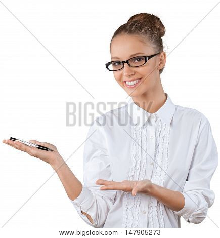 Beautiful young businesswoman pointing at a pen
