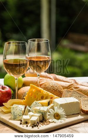 Glasses of Wine with Cheese, Bread and Apples