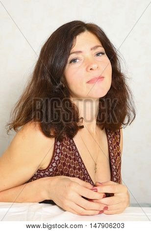 pretty woman with brown hair and decollete dress portrait close up