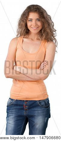 Attractive woman standing with her arms crossed in front of her