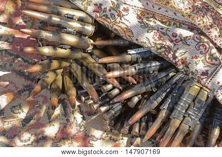 Machine-gun tapes of different caliber a close-up