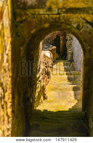A passage to the dungeons of Bamburgh Castle.  Built on a dolerite outcrop itwas previously home to a fort of the native Britons known may have been the capital of the British kingdom of the region