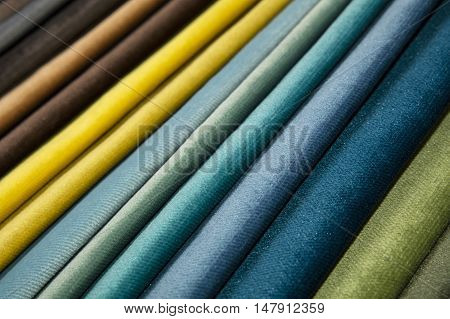 Colorful multicolored fabric samples swatch in textile catalogue palette selection of different colors and textures range to choose for interior design and furniture decoration