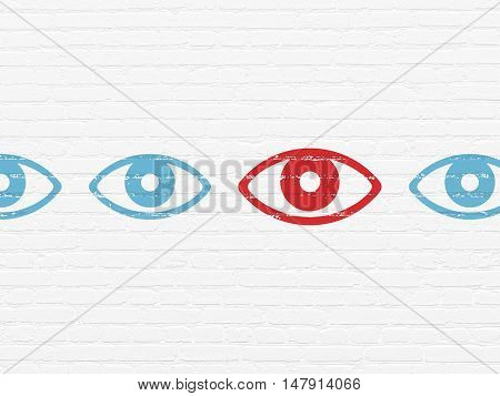 Privacy concept: row of Painted blue eye icons around red eye icon on White Brick wall background