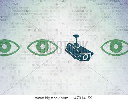 Protection concept: row of Painted green eye icons around blue cctv camera icon on Digital Data Paper background