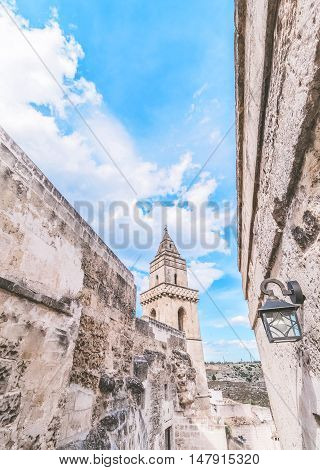 Detail Of Typical Stones (sassi Di Matera) And Church Of Matera Under Blue Sky