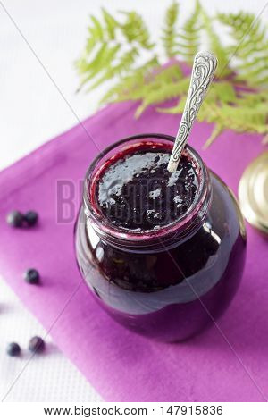Bilberry confiture in a small glass jar