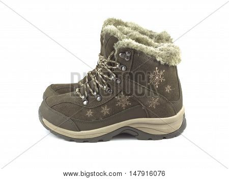 Two beautiful winter brown boots isolated on white side view closeup