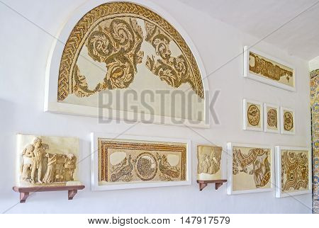 TUNIS TUNISIA - SEPTEMBER 2 2015: The preserved ancient mosaics in Bardo National Museum depicting animals birds plants and complex patterns on September 2 in Tunis.