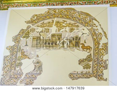 TUNIS TUNISIA - SEPTEMBER 2 2015: The preserved parts of the ancient mosaic with the beautiful Roman villa surrounded by domestic animals Sousse Room of Bardo National Museum on September 2 in Tunis.