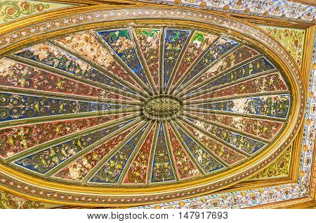 TUNIS TUNISIA - SEPTEMBER 2 2015: The ceiling of the Althiburos Room of Bardo National Museum covered with colorful painted patterns on September 2 in Tunis.