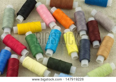 thread, threads, spool, spools, object, objects, cloth, fabric, textile, woven, colored, color, accessories, industry, sew sewing, red, blue. yellow, black, brown, beige, green, many, lot, details, stilllife, still-life, still life poster