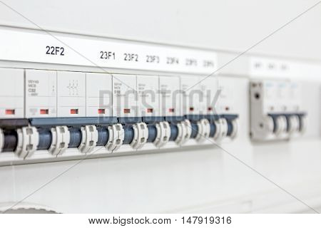 Automatic fuse electrical connector in power lines located inside of switch control panel board.