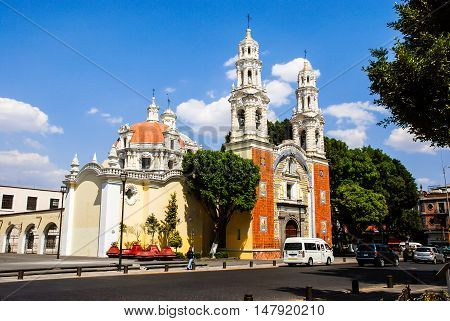 Our Lady Of Guadalupe Church with cars in Puebla, Mexico. It uses the famous local ceramic tiles talavera in colorful patterns on the facade. Famous landmark