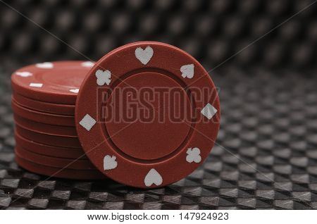 Stack of red poker chips isolated on a black background