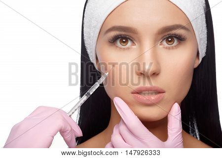 Beautiful young woman does to himself anti-aging injection. Close-up woman hyaluronic acid injection. Injections of skin rejuvenation. Cosmetic procedures, injections, hyaluronic acid.