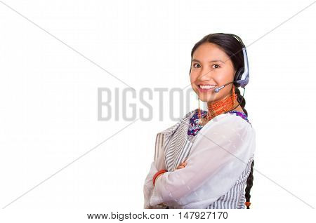 Headshot beautiful young woman wearing traditional andean shawl, red necklace and headset, interacting posing for camera, white studio background.