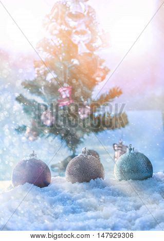 fantasy chrismas ball on snow with chrismas tree abstract background abstract