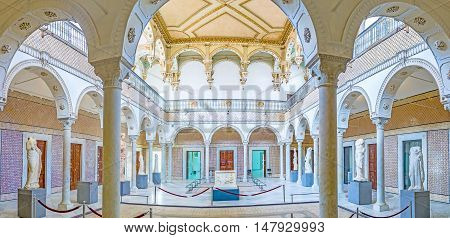 TUNIS TUNISIA - SEPTEMBER 2 2015: Panorama from arcade of the Carthage Room of Bardo National Museum decorated with fretwork glazed tiles and ancient statues on September 2 in Tunis.