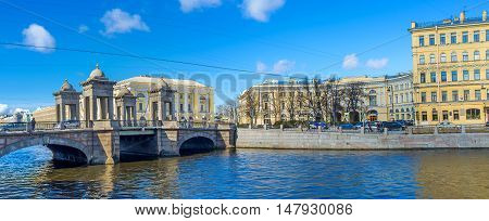 SAINT PETERSBURG RUSSIA - APRIL 25 2015: The Lomonosov Bridge connecting banks of Fontanka River leads to the same named square on April 25 in Saint Petersburg.