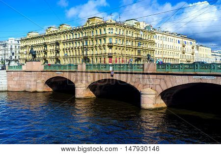 SAINT PETERSBURG RUSSIA - APRIL 25 2015: The best way to enjoy the Anichkov Bridge with the masterpiece statues of Horse Tamers by Pyotr Klodt is to overlook it from Fontanka River embankment on April 25 in Saint Petersburg.