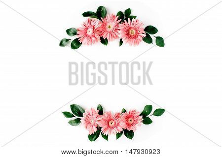 Pink gerbera daisy on white background. Flat lay. Frame wreath