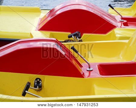 Red-and-yellow paddle boats in the boats parking