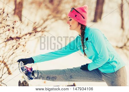 Girl Stretching On Bench In Winter
