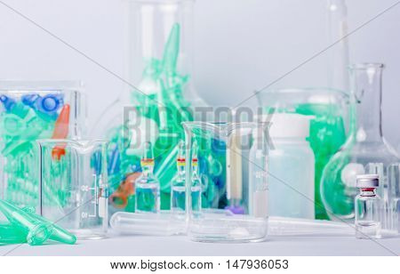 Research lab assorted glassware equipment detail poster