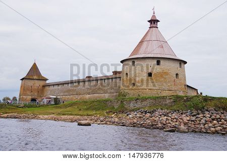 SHLISSELBURG RUSSIA - SEPTEMBER 2015: view from the excursion boat on the architectural and historical monument - the Oreshek fortress on the Walnut island at the source of the Neva.