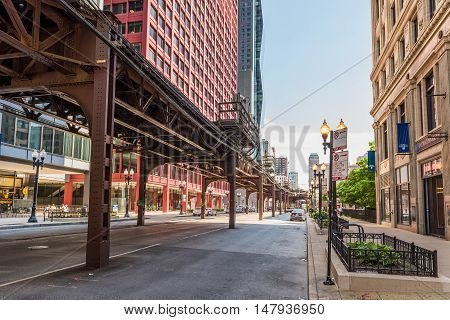 Chicago, USA - May 30, 2016: Downtown street with CTA train metro rail line.