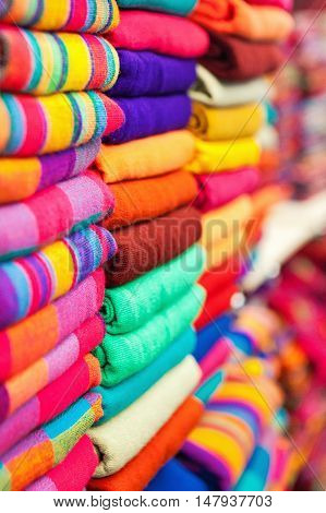 Colorful Mexican tunics for display at a local shop in Cabo San Lucas.