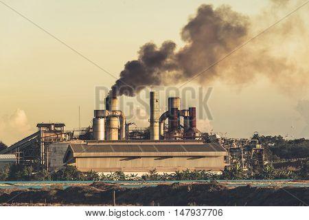 Smokestack in factory landscape background . .
