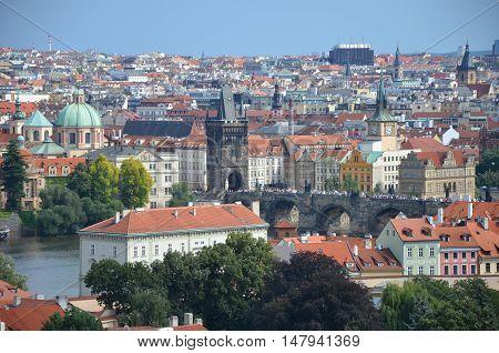 Prague Charles bridge in summer with blue sky