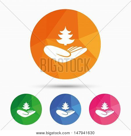 Save forest sign icon. Hand holds Christmas tree symbol. Environmental protection symbol. Triangular low poly button with flat icon. Vector