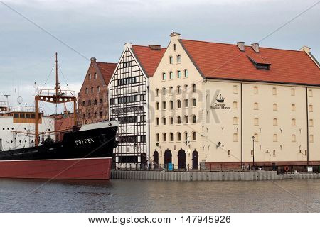 POLAND, GDANSK - DECEMBER 21, 2013: View of the historic buildings of the island Olowianka in Gdansk and the ship-museum freighter Soldek.