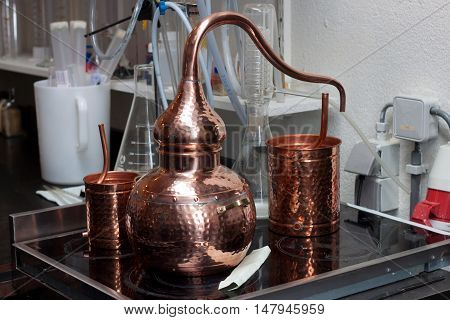 Small copper tank for distillation in the brewery. poster
