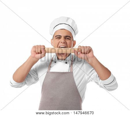Young handsome chef cook with rolling pin isolated on white