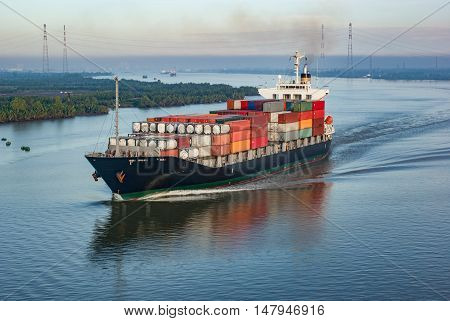 Container ship with many containers in Vietnam harbour