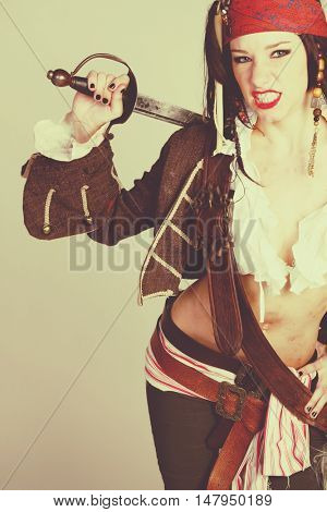 Sexy female pirate holding sword