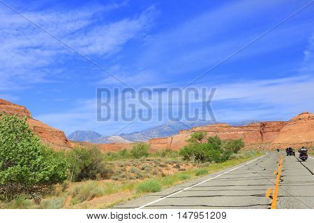 Sightseeing through Glen Canyon National Park, Utah on motorcycles