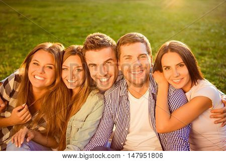 Outside Photo Of Happy Smiling Diverse Five Girlfriends And Boyfriends Resting And Having Fun